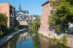 Mechelen - Canal and  Church of Our Lady across the Dyle Royalty Free Stock Photo