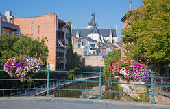 Mechelen - Canal and Church of Our Lady across the Dyle in background Royalty Free Stock Photography