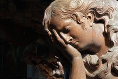 Mechelen - Carved relief of cried angel in Onze-Lieve-Vrouw-va n-Hanswijkbasiliek church Royalty Free Stock Photos