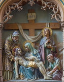 Mechelen - Carved relief Pieta on new gothic side altar in church Our Lady across de Dyle. Royalty Free Stock Photography