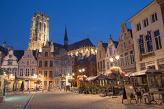 Mechelen - Grote markt and St. Rumbold's cathedral in evenig dusk Royalty Free Stock Photo