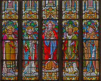 Mechelen - The heart of Jesus and the saints on windowpane in st. Katharine church or Katharinakerk. Stock Images