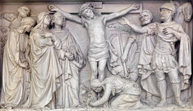 Mechelen - Stone relief the Crucifixion of Jesus in church Our Lady across de Dyle. Stock Photography