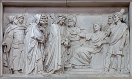 Mechelen - Stone relief Jesus from Pilate in church Our Lady across de Dyle. Stock Photography