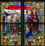 Mechelen - Women at tomb of Jesus scene from windowpane of St. Rumbold's cathedral Stock Photo