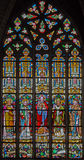 Mechelene - The heart of Jesus and the saints on windowpane in st. Katharine church or Katharinakerk. Stock Photo
