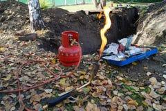 Mechero de gas con el cilindro Foto de archivo libre de regalías