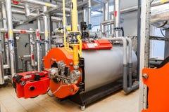 Mechero de gas industrial grande con el sitio de caldera foto de archivo libre de regalías