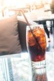 Med is colaexponeringsglas Arkivbild