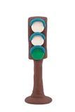 Med en grön trafikljussignalering royaltyfria bilder