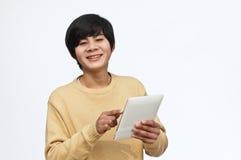 Med den jätteglada pojken för dator Royaltyfria Foton