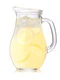 Med is lemonadkanna arkivbild