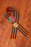 Medaglia 40 di giubileo della vittoria nella grande guerra patriottica di 1941-1945 e nel nastro di George Fotografia Stock Libera da Diritti