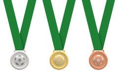 Medaglie di calcio dell'oro, dell'argento e del bronzo Immagine Stock