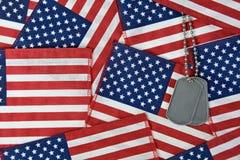 Medagliette per cani militari su collage delle bandiere Fotografia Stock Libera da Diritti