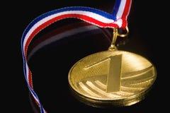 Medaille auf dem schwarzen Hintergrund Stockfotografie