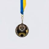 Medaille auf weißem Hintergrund Stockbild