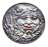 Medaille met clown en overwinningsteken Stock Afbeeldingen