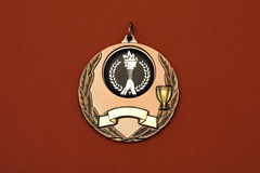 Medal. A medal shot on a red background Royalty Free Stock Images