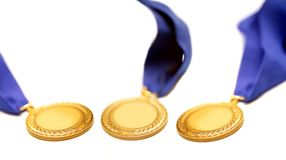 Medal. Detail shot of a gold medals with blue ribbon Stock Image