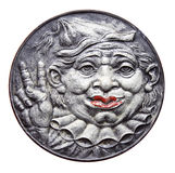 Medal with clown and victory sign Stock Images