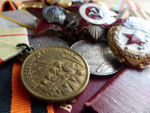 The medal `For the Defense of Stalingrad`. Order of the `Red Star`, `The Great Patriotic War`, a sign of `Guards` and medals. Royalty Free Stock Photography