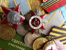 The medal `For the Defense of Stalingrad`. Order of the `Red Star`, `The Great Patriotic War`, a sign of `Guards` and medals. Royalty Free Stock Images