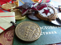 The medal `For the Defense of Stalingrad`. Order of the `Red Star`, a sign of `Guards` and medals. Stock Photos