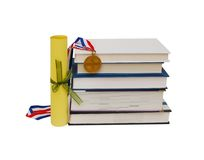 Medal, diploma and books Stock Images