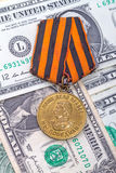 Medal and dollars Royalty Free Stock Photos