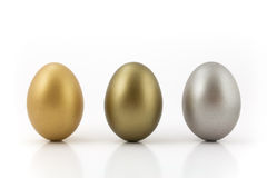 Medal eggs. Golden, bronze and silver eggs isolated on white background royalty free stock photos