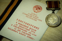 Medal for employment achievements. TOMSK, RUSSIA - DECEMBER 21, 2016: Medal book and the medal for employment achievements Royalty Free Stock Photography