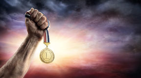 Medal Of First Place In Hand. Victory Concept stock photography
