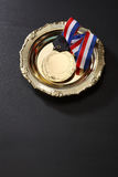 Medal. Golden medal in a glolden tray Royalty Free Stock Images