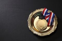 Medal. Golden medal in a glolden tray Royalty Free Stock Photo