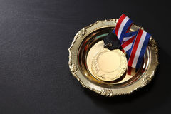 Medal. Golden medal in a glolden tray Stock Photo