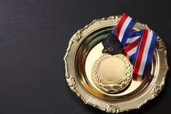 Medal. Golden medal in a glolden tray Stock Photography