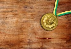 Medal. Golden medal on the table Royalty Free Stock Images