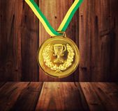 Medal. Golden medal on the wood background Royalty Free Stock Photos