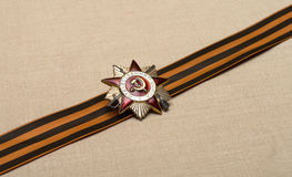 Medal on a ribbon. Patriotic war award on St. George's Ribbon Stock Photography