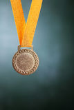 Medal. Selective focus on the medal in front of blackboard stock photo