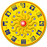 Medal with signs of the zodiac. Decorative round golden badge with a plastic sun with colored balls and the signs of the zodiac around Royalty Free Stock Images