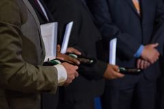 Medal of Valor Ceremony. Men in suits, medal of valor recipients Stock Image