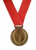 Medalha de ouro na fita vermelha Fotografia de Stock