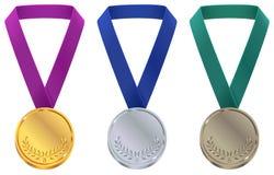 Medalha do ouro, a de prata e a de bronze no molde dos Jogos Olímpicos do inverno Ajuste a medalha do esporte na fita ilustração stock