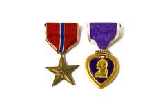 Medalhas da estrela de bronze e do coração roxo Fotos de Stock
