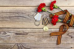Medalhas da grande fita patriótica da guerra, do ` s de St George e do carna vermelho imagens de stock royalty free