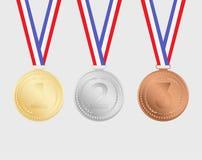 Medalhas do ouro, as de prata e as de bronze com as fitas isoladas no fundo Imagens de Stock Royalty Free