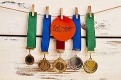 Medalhas na fileira Fotos de Stock