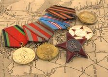 Medalhas no mapa Fotografia de Stock